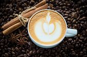Cup Of Coffee With Latte Art On Coffee Bean Background