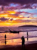 Taking photos on the Sunset on the beach of Ao Nang in Krabi Thailand