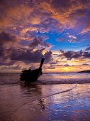 Long tail boat Sunset on the beach of Ao Nang in Krabi Thailand