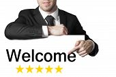 Businessman Pointing On Sign Welcome