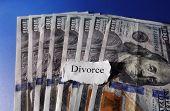 foto of divorce-papers  - Torn paper with Divorce text on hundred dollar bills - JPG