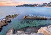 stock photo of tide  - The view from the headland down into Giles Baths rockpool at Coogee in a mid tide - JPG
