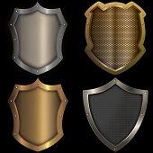 Gold And Silver Shields Set On Black Background.