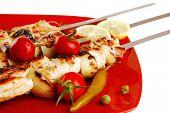 fresh roast chicken shish kebab on red platter