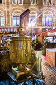 Moscow, Russia - December 24, 2014: Christmas Fair (market) At Night On Red Square. Big Samovar On T