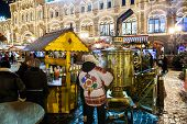 Moscow, Russia - December 24, 2014: Christmas Fair At Night On Red Square. Big Samovar And  Seller I