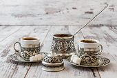 stock photo of traditional  - Traditional Turkish coffee in traditional silver cup with silver pot and tray - JPG