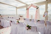 picture of wedding arch  - wedding isle and arch with weddings chairs and wedding flower decoration - JPG