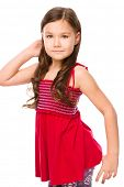 Portrait of a happy little girl in red dress raising her hand up, isolated over white