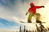 stock photo of deep blue  - Snowboarder jumping through air with deep blue sky in background - JPG