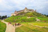 Rasnov, Romania - July 16, 2014: Tourists Visit The Medieval Castle In Rasnov. Fortress Was Built Be
