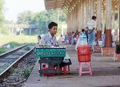 Vendor At A Railway Station In Yangon, Myanmar.