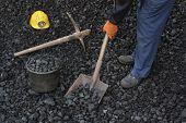 pic of power-shovel  - Miner man working at shoveling coal mine - JPG