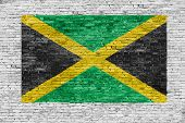 Flag Of Jamaica Painted Over Brick Wall
