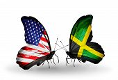 stock photo of jamaican flag  - Two butterflies with flags on wings as symbol of relations USA and Jamaica - JPG