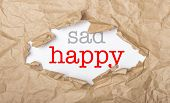Happy And Sad Words On Paper And Torn Cardbox