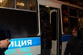 Police officers detain protesters in Moscow