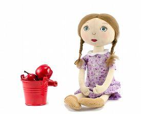 image of rag-doll  - Rag doll with bucket filled by apples on a white background - JPG
