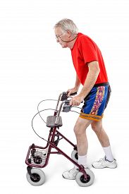 image of rollator  - Sick old man walking with a walker - JPG