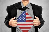 stock photo of heroes  - Business man tears open his shirt with american flag in a super hero fashion getting ready to save the day - JPG