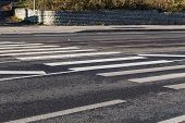 stock photo of pedestrian crossing  - Pedestrian zebra crossing white stripes on the road - JPG