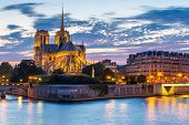 pic of notre dame  - Notre Dame Cathedral with Paris cityscape and River Seine at dusk - JPG