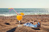 picture of sunny beach  - Cocktails and shoes for the beach for the beach on beach background - JPG