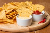 image of nachos  - nachos with various sauces on wooden table - JPG