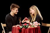 pic of marriage proposal  - Man proposing marriage to a surprised woman on black background - JPG