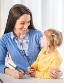 picture of babysitter  - Mother and daughter are having fun while drawing at home - JPG