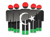 stock photo of libya  - People with flag of libya isolated on white - JPG