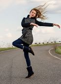 stock photo of flowing hair  - girl with flowing hair dancing on the background of the sky - JPG