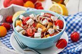 stock photo of greeks  - Fresh delicious tomato onion and feta greek salad - JPG