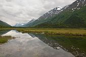 Mountains And Clouds Reflecting In Kenai Marsh