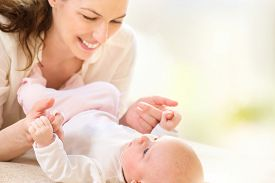 stock photo of hug  - Mother and her Newborn Baby - JPG