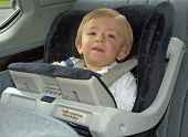 Boy In Safety Seat