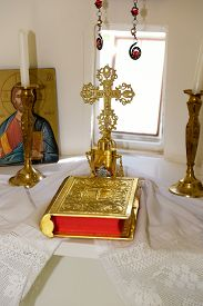 picture of baptism  - Interior of a very small greek chapel with holy bible golden cross and oil for baptism - JPG