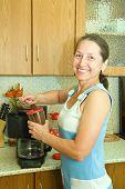 Elderly Woman Making Coffee