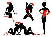 Silhouette of beautiful girls is in socks and cap of Santa Claus. Vector