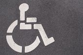 image of physically handicapped  - a handicap symbol painted on a parking space - JPG