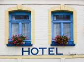 Hotel In French Town With Hotel Written On Wall poster