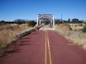 stock photo of winona  - A section of old route 66 and abandoned bridge at Winona - JPG