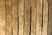 pic of wooden fence  - old rustic fence from aging farm yard used as wall - JPG