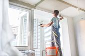 Plasterer renovating indoor walls and ceilings. poster