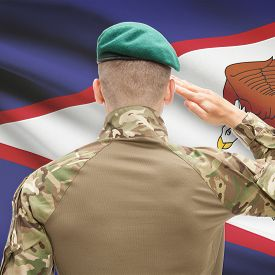 picture of samoa  - Soldier in hat facing national flag series  - JPG
