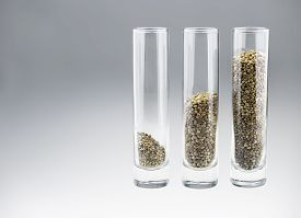 foto of seed bearing  - Three glasses with three kinds of hemp seeds in a grey gradient background - JPG
