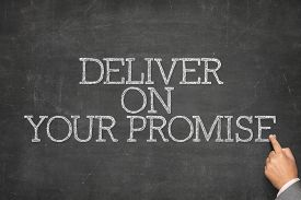 stock photo of promises  - Deliver on your promise text on blackboard with businessman hand pointing - JPG