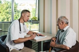 stock photo of status  - Medical worker asks about the patient - JPG