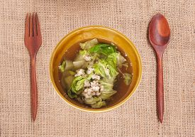 pic of rainy season  - Soup made from pork and vegetable on cloth background Food rainy season - JPG