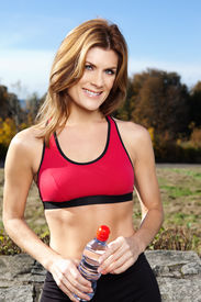 stock photo of athletic woman  - A shot of an active beautiful caucasian woman outdoor in a park - JPG